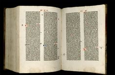 Image of the Gutenberg Bible open to pages 315 verso and 316 recto.