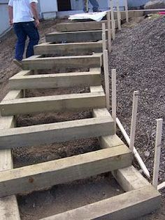 Landscape timber stairs before being backfilled with decomposed granite. #curvedraisedbeds