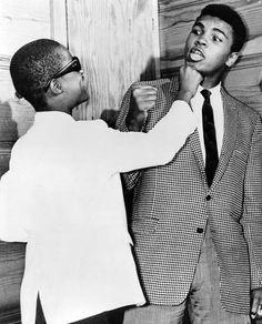 13 year old Stevie Wonder goofing around with Muhammad Ali at The Apollo, Harlem, 1963