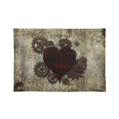 Steampunk Heart Placemats. This design was inspired by Time and Love! The Heart represents love, the cogs & gears around it represent the mechanism inside a clock and are also symbolic of the complexities of the heart! The text and the grungy background were inspired by Victorian London to compliment the steampunk effect! #Love #Heart #Valentine #Steampunk #Gothic #Victorian #Hearts #Grunge #London #Grungy #Red #Brown #Cogs #Gears #Valentines #Rust #Rusty #Goth #Dark #Placemat #Placemats