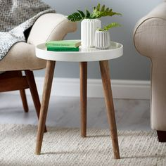 With its smooth painted top and three wooden legs, our Lucy table is the perfect touch to your bedroom or living space. Use to display succulents or store trinkets and knickknacks.