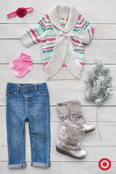 Layer on warmth with this cozy, cold-weather, classic Fair Isle cable sweater, jeans and faux-fur boots in silver. Possibly the cutest look for her this season.