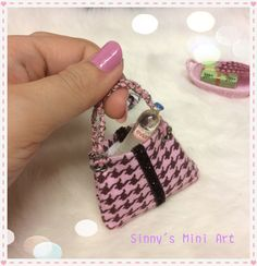 A personal favorite from my Etsy shop https://www.etsy.com/listing/257611909/miniature-doll-purse-key-chain