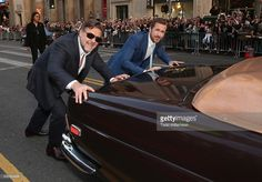 Russell Crowe and Ryan Gosling push a car to the premiere of Warner Bros. Pictures' 'The Nice Guys' at TCL Chinese Theatre on May 10, 2016 in Hollywood, California.