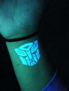 Autobot symbol in UV ink. My favourite tattoo I have so far.