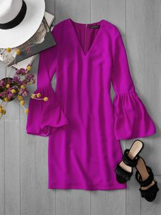Add a pop of vibrant color to the night in our magenta Bell-Sleeve Dress. An effortlessly elegant shift dress with of-the-moment bell sleeves. The simplicity of the frock's design begs for stunning accessories like our raffia sandals, and the low V neck is perfect for adding a statement necklace.