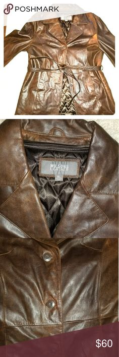 """Wilson's Brown Leather Belted & Lined Coat XL Leather with removable quilted lining.  Leather has natural highs and lows to the color.  Seaming details on front and back. 3-button closure with leather belt.  Slit pocket on each side.  Comes to mid-thigh on a 5'6"""" person (see pics).  Approx 20"""" from armpit to hem. Approx 43"""" across the bust. Wilsons Leather Jackets & Coats Trench Coats"""