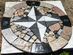 """Want a fun and creative day or weekend project? Then the Compass Rose is perfect for you! Piece together the recycled granite and quartz pieces to make a masterpiece all your own! The pieces are 1.25"""" thick and with the correct base, are strong enough to have a truck driven over them. They come in 36"""" and 48"""" and are a great addition to your garden, outdoor patio or anywhere else! #homedecor #home #decor #landscaping #granite #compass #diy CJ's Hearth and Home http://cjshearthandhome.com"""