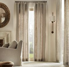 Washed Belgian Linen Drapery    Black curtain rods with neutral curtains.   Simple unheaded curtains.