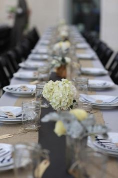 long tables with burlap runners and yellow hydrangeas - @Christina Tomaselli