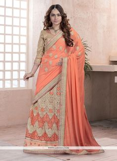 Sensible colors and excellent designs and romantic moods are reflected with an alluring style. Be the sunshine of everyone's eyes dressed in this beautiful orange georgette and net lehenga saree. Th...
