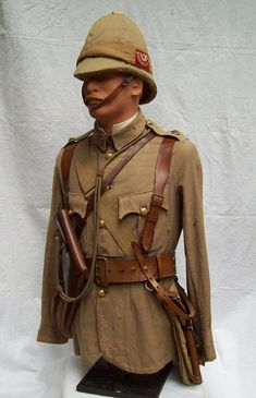 Infantry officers serge frock as per Dress Regulations for Officers 1900,  of Shropshire Light Infantry,  double brace Sam Browne belt for revolver and sword. over shoulders  haversack water bottle.