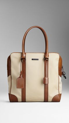 Cotton Gabardine Portrait Holdall | Burberry $1,150.00 Item 38794381 DARK OCHRE         Heritage cotton gabardine portrait holdall with refined leather trim         Zip closure with lock detail, luggage tag and rolled leather handles         Matte metal hardware         36.5 x 39 x 15cm         14.4 x 15.4 x 5.9in         100% cotton with calf leather trim         Check lining         Imported