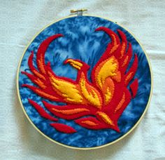 phoenix hoop - beautifully done.... even tho I'm not a hoop fan.