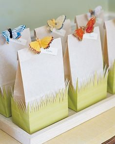 Favor Bags: you'll need a green gift bag and an off-white lunch bag that has the same-size base. Keeping green bag folded, cut off top two-thirds. Cut a grass design into the bottom portion, being careful not to cut the base; unfold. Place double-sided tape on the base of off-white bag, and fit it into green bag. Hot-glue a miniature clothespin to a fabric butterfly (remove wire if necessary); let dry. Pin butterfly and name tags to top of bag.