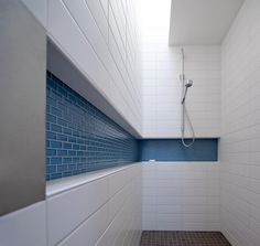 White subway tiles with coloured tile inset