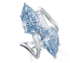 MAGNIFICENT AND VERY RARE FANCY VIVID BLUE AND FANCY INTENSE BLUE DIAMOND RING Of toi et moi design, set with two pear-shaped diamonds, one fancy vivid blue weighing 3.08 carats, the other fancy intense blue weighing 2.83 carats, between tapered baguette diamonds.