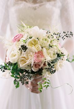 Natural Wedding Bouquets: Pink and White Roses, Ranunculus, Astilbe, Berries, and Greenery   Brides.com
