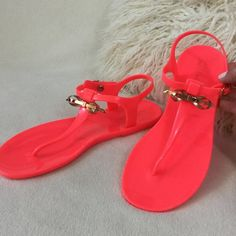 """Ted Baker BRAND NEW neon jelly bow sandals Ted Baker BRAND NEW pinkish/orange neon jelly sandals.  The Ted Baker bow is in a beautiful rose gold color. These have only been tried on at the store and are in excellent condition. Ted size 8 women's US size 10   Adjustable buckle insoles measure almost 11"""" long for reference Ted Baker Shoes Sandals"""