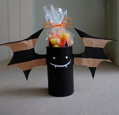 Playful Bats from Paper Bags - I love this! Paper bags are used for the wings. Use a toilet paper roll and get a black sharpie and a white paint marker, or even white craft paint for the face. I know this is shown as a little candy holder/kid craft, but I love it so much I want to make one and set it on my computer desk to hold pens!