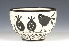 Birds on a Wire Bowl by Jennifer Falter. A whimsical wheel thrown ceramic bowl, decorated with sgraffito using black slip, featuring a pattern of spirals. Glazed to give a glossy finish. Each is unique; size and design may vary slightly. Holds approximately 30 oz. Dishwasher and microwave safe.