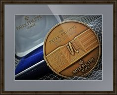 "Patek Philippe Geneve Commemorative Medal Coin // Paper: enhanced matte; Glazing: acrylic; Moulding: dark brown, belmont medium olive; Top Mat: blue, bridgewater // Price starts at $163 (Petite: 19"" x 21""). // Customize at http://www.imagekind.com/Patek-Philippe-Geneve-PPG_art?IMID=1f63993e-3b0d-4b44-8521-e4fef1f8974d"