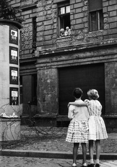 Girls in a west Berlin street chat with their grandparents in the eastern zone, August 14, 1961 :: from Berlin. Portrait of a City.
