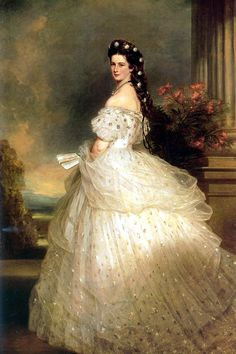 The painting by Franz Xaver Winterhalter shows the 28-year old empress wearing a gown sewn with diamond stars matching the diamond stars in her hair. Created by the famous Parisian couturier Charles Frederic Worth, this dress made Elisabeth's beauty famous the world over.