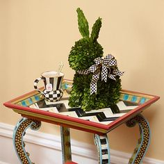 : Decorate your spring table with this lush work of art. Donning a dapper accent of Courtly Check® ribbon, our Rabbit Topiary brings fresh spring style to your decor any time of year.