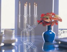 Flaunt a forest of Pyrex tubes as you display candles on the table with the Mistic Vase or Candleholder.