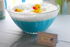 Looking for Baby Shower ideas? What about Rubber Ducky Punch? Made with Blue Hawaiian Punch, Vanilla ice cream and sprite or 7-up. It's the bubbles in the soda mixing with the ice cream that creates the foam effect. Just don't forget the rubber ducks.