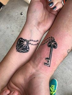 Lock and Key Connecting Arm Tattoos