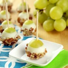 Plump grapes speared and dipped in Vanilla Candiquik then rolled in chopped pecans! Delicious and perfect for any party!