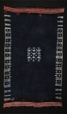 Africa | Mahmoudi (woman's mantle) from the Berber people from the border of Tunisia and Libya | Wool with cotton supplementary patterns, tie-dyed at ends. The piece is dyed after weaving and the cotton resists the indigo.