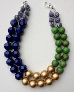 The Emma - emerald green howlite, gold and navy blue geometric bead statement necklace. Measures approximately 19 inches and length and is Bead Jewellery, Beaded Jewelry, Jewelery, Jewelry Necklaces, Handmade Jewelry, Boho Jewelry, Jewelry Crafts, Jewelry Art, Fashion Jewelry