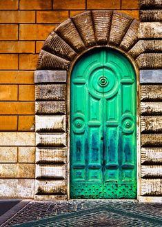 Oxidized copper door in malachite green and ocean blue