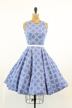 Charming and covetable Grenelle Estevez 1950s dress! Done in a soft sky blue cotton with white windowpane striated plaid. Cut in shoulders, notched