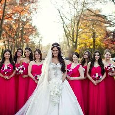 Red hot bridesmaids and stunning @pninatornai bride, @disney_momma86. Everything about this is gorgeous! Especially love how the white orchid bouquet makes the details sparkle a bit more in this fabulous gown.