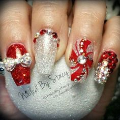 A bedazzled red, gold and silver themed Christmas nail art. Sparkling is in the house which is why donning this nail art in glitter polish, beads and more embellishments makes it even more stunning to look at.