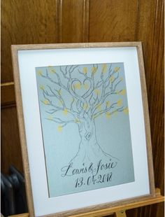 Hand drawn wedding tree with ink pads to make fingerprints and leaves