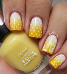 Dotted Yellow Nail Design