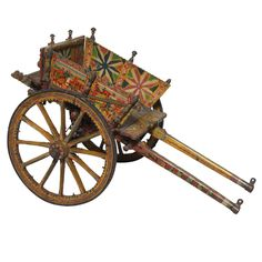 Antique Italian Hand Painted Child's Cart Italy 19th century Whimsical Italian goat cart. Beautifully hand painted with multiple scenes. The wood spoked wheels are supported by hand forged iron.