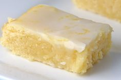 Lemonies (Lemony Brownies) Not quite a lemon bar, not quite a brownie, these little bites of sunshine get the cute name Lemonies. Packed with lemon flavor and topped with a tangy glaze, they are a real sweet treat! Lemon Desserts, Lemon Recipes, Just Desserts, Baking Recipes, Sweet Recipes, Cookie Recipes, Delicious Desserts, Dessert Recipes, Yummy Food
