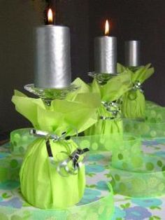 Wine glasses decorated with lime napkins and ribbons as candle holders - great for making any table more festive
