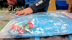 putting objects and paint in a zip lock bag - Teaching 2 and 3 Year Olds