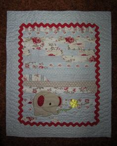 Elephant Baby Quilt.  Jelly roll quilt.  Peace, Robert from nancysfabrics.com