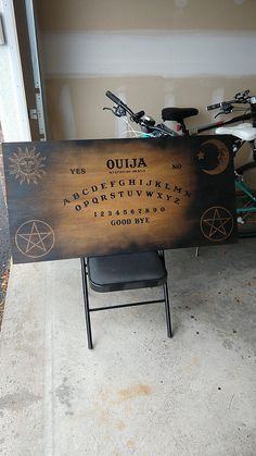 It's nowhere near finished yet but I'm really excited with how my Ouija board coffee table is coming along and wanted to share! This is the table top before sealing. Diy Ouija Board, Ouija Table, Wiccan Spell Book, Wood Burning Crafts, Gothic Aesthetic, Diy Coffee Table, Witch House, Victorian Steampunk, Gothic Home Decor