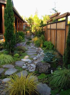 Steal these cheap and easy landscaping ideas for a beautiful backyard. Get our best landscaping ideas for your backyard and front yard, including landscaping design, garden ideas, flowers, and garden design. Small Backyard Landscaping, Landscaping Ideas, Walkway Ideas, Backyard Privacy, Rock Walkway, Fence Ideas, Path Ideas, Backyard Patio, Backyard Designs
