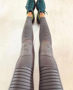 034b89ada5241 As seen on Kendall Jenner, shop the ALO Yoga women's Moto Legging in white,  black, rich navy, and stormy heather.