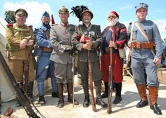 Parisians and tourists alike were greeted with the surprising sight of 'soldiers' in vintage army uniforms from Czarist Russia, Imperial Germany, Austria-Hungary, Italy and France roaming around the capital on France's national holiday.